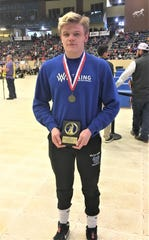 Walton-Verona senior Daulton Mayer with his awards for being 195-pound state champion KHSAA state championship wrestling tournament, Feb. 15, 2020, Alltech Arena, Lexington, Ky.