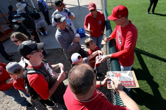 Cincinnati Reds starting pitcher Sonny Gray (54) signs autographs for fans, Sunday, Feb. 16, 2020, at the Cincinnati Reds Spring Training Facility in Goodyear, Arizona.