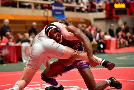 Bartley Thomas (right) of Elder topped Brecksville's Anthony Rizzo in the 160lb class quarterfinal at the Division I OHSAA State Wrestling Dual Team Tournament, Feb. 16, 2020.