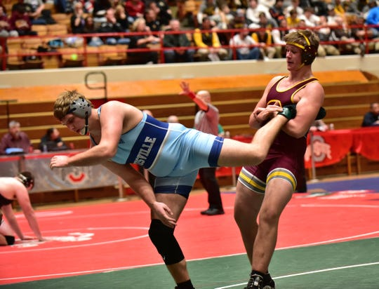 Griffin Peacock works the leg of  Louisville's Blake Robbins in the 220lb class at the Division II OHSAA State Wrestling Dual Team Tournament, Fe. 16, 2020.