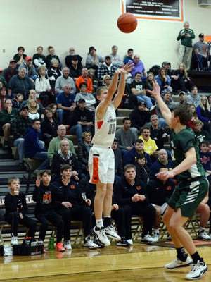 Kole Hamilton hoists a 3-pointer during Ridgewood's 69-63 overtime win against Malvern on Saturday in the IVC Showcase at Claymont.