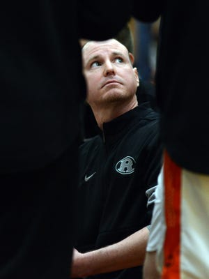 Ridgewood coach Troy Dolick talks to his team during a timeout during the Inter-Valley Conference Showcase game against Malvern. Dolick was named Division III Coach of the Year by the Ohio Prep Sportswriters Association on Monday.