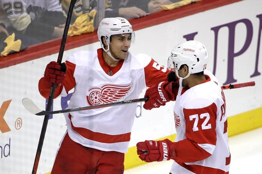 Detroit Red Wings' Valtteri Filppula, left, celebrates his goal with Andreas Athanasiou during the first period against the Pittsburgh Penguins in Pittsburgh, Sunday, Feb. 16, 2020.