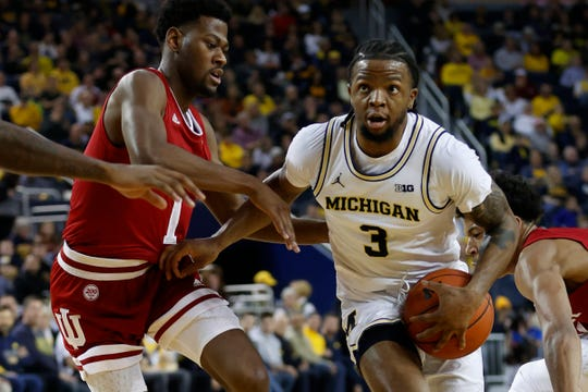 Michigan guard Zavier Simpson dribbles against Indiana guard Al Durham in the first half at Crisler Center in Ann  Arbor, Feb. 16, 2020.