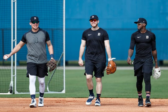 From left, JaCoby Jones, C.J. Cron and Cameron Maybin walk off the field after practice during Detroit Tigers spring training at TigerTown in Lakeland, Fla., Sunday, Feb. 16, 2020.