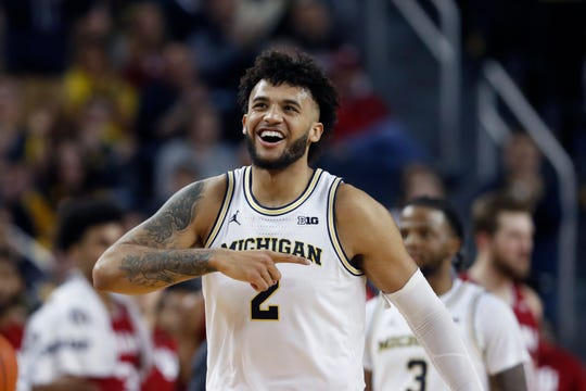 Michigan forward Isaiah Livers walks to the bench after a play during the second half against Indiana, Sunday, Feb. 16, 2020, in Ann Arbor.