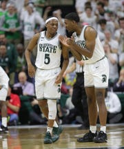 Michigan State's Cassius Winston, left, and Aaron Henry talk during the game against Maryland on Saturday, Feb.15, 2020 at the Breslin Center in East Lansing.