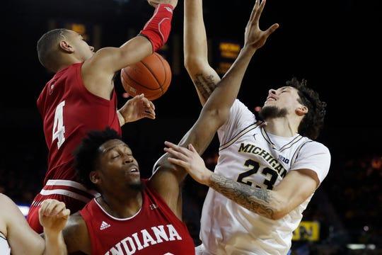 Michigan's Brandon Johns Jr. and Indiana's Trayce Jackson-Davis (4) and De'Ron Davis contest a rebound during the second half Sunday, Feb. 16, 2020, in Ann Arbor.