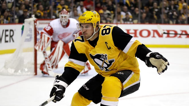 FILE - Pittsburgh Penguins star Sidney Crosby will miss the start of the regular season after undergoing wrist surgery.