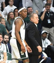 Spartans' Cassius Winston and head coach Tom Izzo on the sidelines in the second half of the 66-60 Maryland victory over MSU.