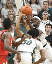 Spartans' Gabe Brown battles under the basket in the first half.