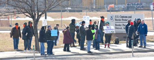 About three-dozen people protest in front of the U.S. Customs and Border Protection Border Patrol Station Detroit on E. Jefferson across from the Chrysler Jefferson North Assembly plant, Sunday afternoon, Feb. 16, 2020.