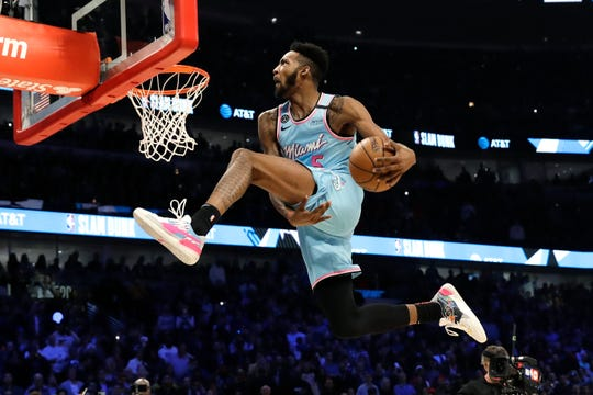 Miami Heat's Derrick Jones Jr. heads to the basket during the NBA All-Star slam dunk contest.