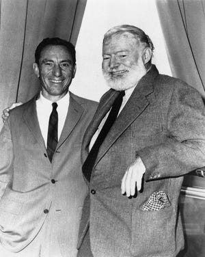 """FILE - In this undated file photo, A.E. Hotchner, left, and author Ernest Hemingway pose for a photo in Seattle. Hotchner was staging Hemingway's story """"A Short Happy Life"""" in a pre-Broadway tour in Seattle."""