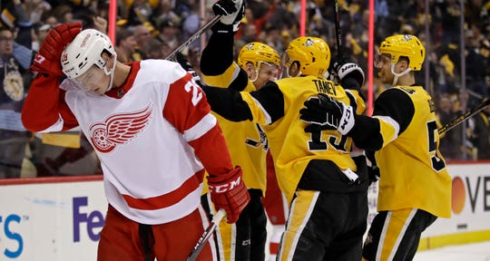 The Penguins' Patric Hornqvist, center rear, celebrates his goal Sunday as Red Wings defenseman Gustav Lindstrom (28) skates back to his bench during the second period in Pittsburgh.