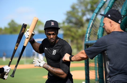 Tigers outfielder Cameron Maybin, left, talks with quality control coach Josh Paul at a volunteer workout.