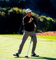 Adam Scott acknowledges the crowd after a birdie on the 13th hole.
