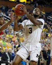 Michigan guard Zavier Simpson was one of five Wolverines to score in double figures Sunday.