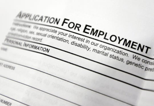 This April 22, 2014, file photo shows an employment application form on a table during a job fair in Hudson, N.Y.