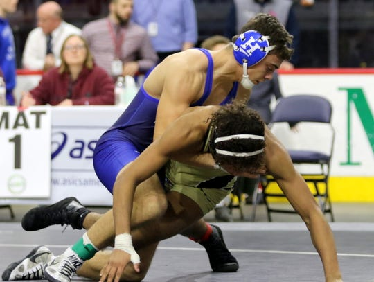Jarrett O'Connell, top, of Horseheads wrestles Corning's Charles Loucks in the 160-pound Division I final at the Section 4 Wrestling Championships on Feb. 15, 2020 at the Floyd L. Maines Veterans Memorial Arena in Binghamton.