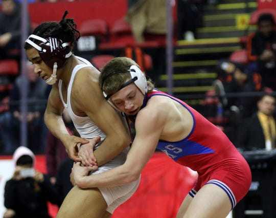 Ithaca's Daniel Parker, left, was an 11-7 winner over Chenango Forks' Cooper Rice in the Division I 126-pound championship match at the Section 4 Wrestling Championships on Feb. 16, 2020 at the Floyd L. Maines Veterans Memorial Arena in Binghamton.