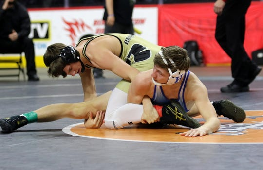 Corning's Drew Witham, top, was an 18-2 winner over Horseheads' Calum Houper in the Division I 132-pound championship match at the Section 4 Wrestling Championships on Feb. 16, 2020 at the Floyd L. Maines Veterans Memorial Arena in Binghamton.