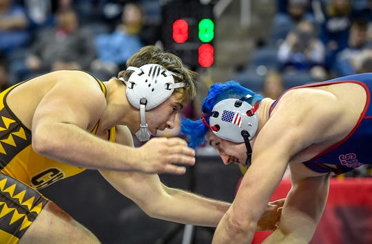 Central's McKinley Kemper (left) and Heritage Hills' Phoenix Rodgers both advance to the state wrestling meet, which starts on Friday at Bankers Life Fieldhouse in Indianapolis. Rodgers placed first and Kemper second in semistate last Saturday at Ford Center.