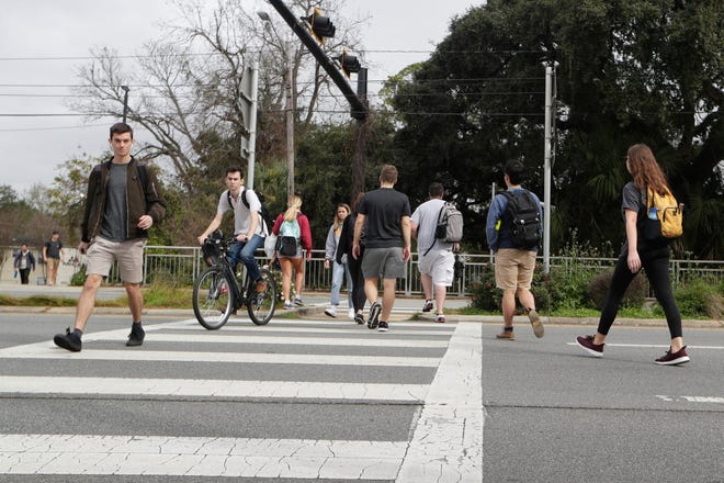 Students use the crosswalk between Woodward Avenue and Stadium Drive to cross West Tennessee Street Wednesday, Feb. 5, 2020. Natalie Nickchen, an FSU student, was killed in the crosswalk after being hit by a car last week.
