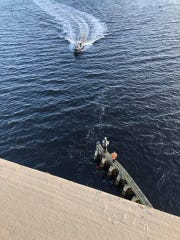 The Fort Myers Fire Department helped in the rescue of a man found clinging to a piling on the Caloosahatchee River Saturday morning.