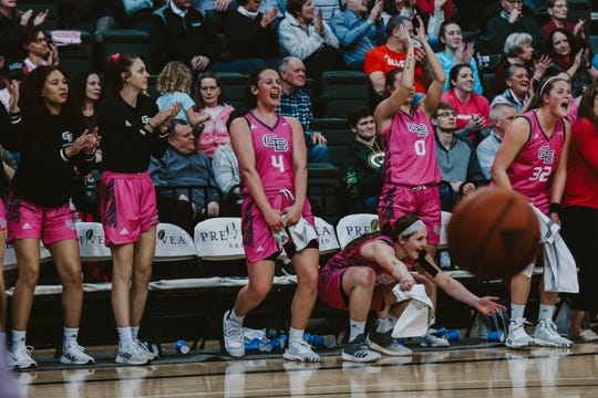 UWGB players celebrate during a commanding win over Oakland at the Kress Center on Sunday.