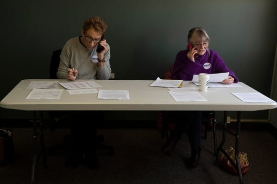 Volunteers Sherry Pittinger (left), of Anderson, and Ellen Martell, of Greenville, make phone calls to potential voters from the Joe Biden Upstate Office in Greenville Saturday, Feb. 15, 2020.