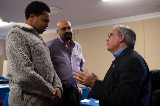 "Paul Merlo (from right), a Spartanburg organizer for Tom Steyer, talks to Michael Forsyth, from Greenville County, and his son, Brett, 18, during a ""Get Out the Vote"" party organized by the Greenville Democratic Black Caucus at Soteria Community Development Corporation Saturday, Feb. 15, 2020."