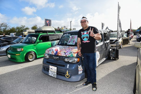 Marco Fernandez stands beside his Japaanese pop culture-themed 2014 Nissan Cube during Battle Showcase 4 at Guam International Raceway in Yigo, Feb. 15, 2020.