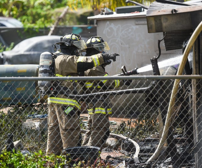 Guam Fire Department firefighters work to extinguish a fire at a Chalan Balaku residence in Dededo on Feb. 16, 2020. Two minors were transported to the Guam Memorial Hospital with minor injuries, according to GFD spokesperson Cherika Lou Chargualaf.