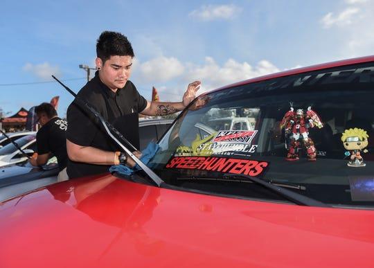 Rojell Unipig wipes down his 2013 Scion for the Battle Showcase 4 car show at Guam International Raceway in Yigo, Feb. 15, 2020.