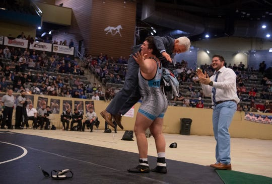 Union County head wrestling coach Robert Ervin is hoisted over his son Matthias Ervin's shoulder after winning the 285-pound championship match at the KHSAA State Wrestling championship at Alltech Arena in Lexington, Ky., Saturday, Feb. 15, 2020.