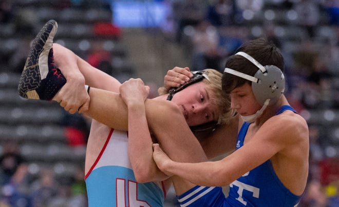 Union County's Trayce Eckman works his way to a 16-1 technical fall against Paducah Tilghman's Jack James in the 113-pound semifinal match at the KHSAA State Wrestling tournament at Alltech Arena in Lexington, Ky., Saturday, Feb. 15, 2020.