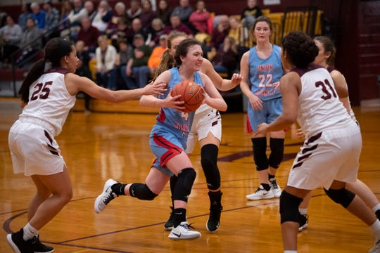 Union County's Madison Morris (4) drives the paint against Webster County at Webster County High School Monday night.