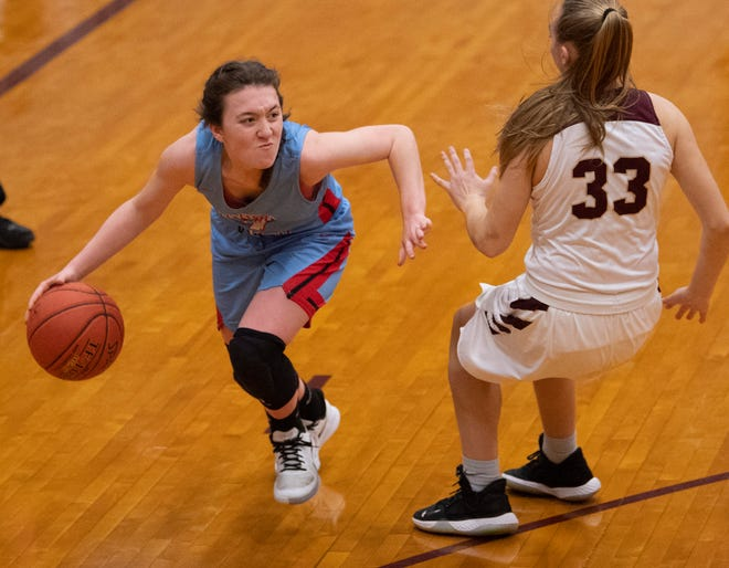 Union County's Madison Morris (4) drives against Webster County's Katelyn Cates (33) at Webster County High School Monday night.