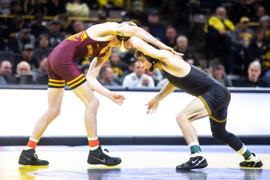 Iowa's Austin DeSanto, right, wrestles Minnesota's Boo Dryden at 133 pounds during a NCAA Big Ten Conference wrestling dual, Saturday, Feb. 15, 2020, at Carver-Hawkeye Arena in Iowa City, Iowa.