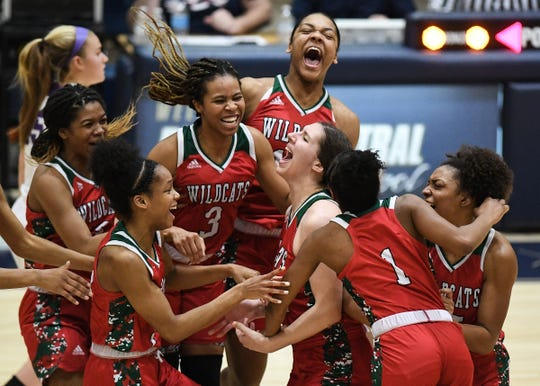 The Lawrence North Wildcats celebrate second after the buzzer after defeating the Brownsburg Bulldogs in the girls basketball regional final on Saturday, Feb. 15, 2020. Lawrence North defeated the Brownsburg Bulldogs 58-57.