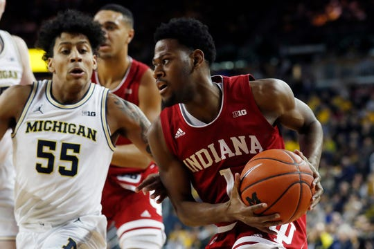 Indiana guard Al Durham (1) is defended by Michigan guard Eli Brooks (55) during the first half of an NCAA college basketball game, Sunday, Feb. 16, 2020, in Ann Arbor, Mich.