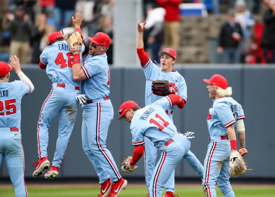 Ole Miss baseball players celebrate after their win against top-ranked Louisville in the third game of a weekend series on Feb. 16, 2020 at Swayze Field in Oxford, Mississippi.