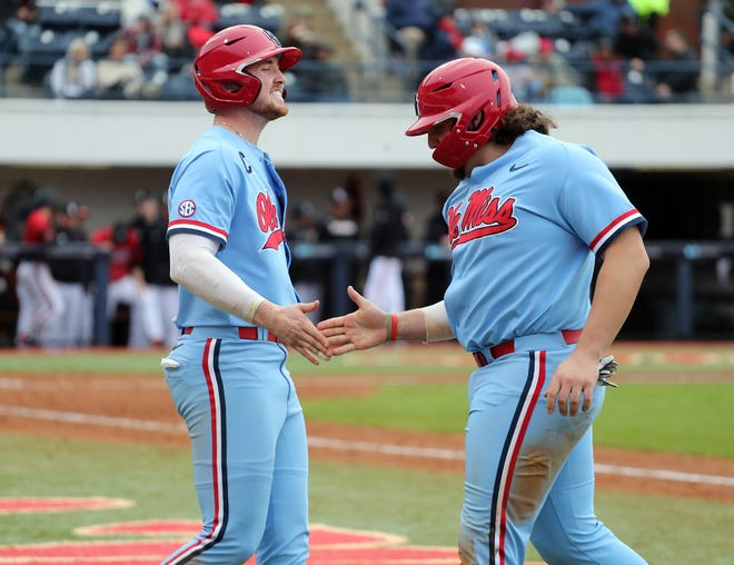 Ole Miss baseball players Cael Baker (right) and Tim Elko (left) celebrate vs Louisville in the third game of a weekend series on February 16th, 2020 at Swayze Field in Oxford, MS.  Twitter and Instagram: @OleMissPix  Buy Photos at RebelWallArt.com
