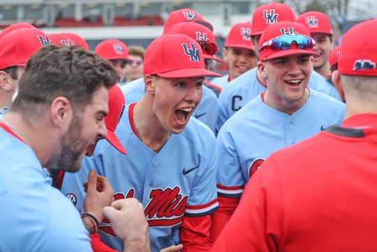 Ole Miss baseball players cheer in their postgame huddle after winning against Louisville in the third game of a weekend series on Feb. 16, 2020, at Swayze Field in Oxford, Mississippi.
