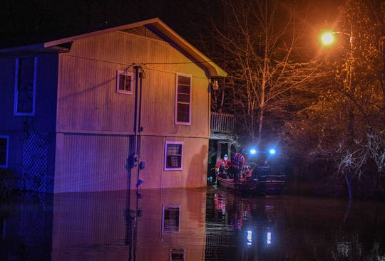 Flowood emergency personnel rescue Janis Hart Landrum from her home on Flowood Drive as water from the Pearl River continues to rise Saturday, Feb. 15, 2020.