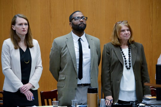 Defendant Willie Cory Godbolt stands with attorney Alison Steiner, left, and attorney Alison Steiner, right during opening arguments in his trial in Magnolia, Miss. Saturday, Feb. 15, 2020.  Godbolt has pleaded not guilty to four counts of capital murder, four counts of murder, one count of attempted murder, two counts of kidnapping and one count of armed robbery.