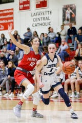 Central Catholic's Tori Thompson (5) dribbles against Frankton's Addie Gardner (10) during the fourth quarter of the IHSAA girls basketball regional #10 championship game, Saturday, Feb. 15, 2020 in Frankton.