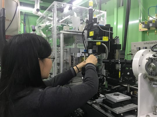 Linda Nie, associate professor in Purdue University's Department of Health Sciences, conducts an experiment at the synchrotron facility at the Pohang (South Korea) Accelerator Laboratory.