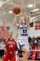 Central Catholic's Karsyn Cherry (23) goes up for two past Frankton's Ava Gardner (20) during the fourth quarter of the IHSAA girls basketball regional #10 championship game, Saturday, Feb. 15, 2020 in Frankton.